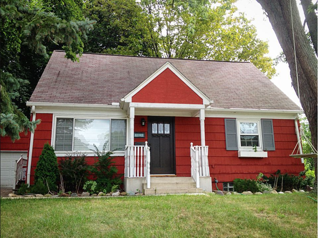 A craftsman style home before an exterior facelift was completed