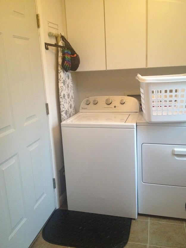 Before photo of a laundry room before remodel