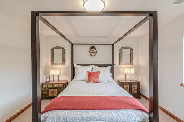 Photo of lower level guest bedroom in whole home renovation