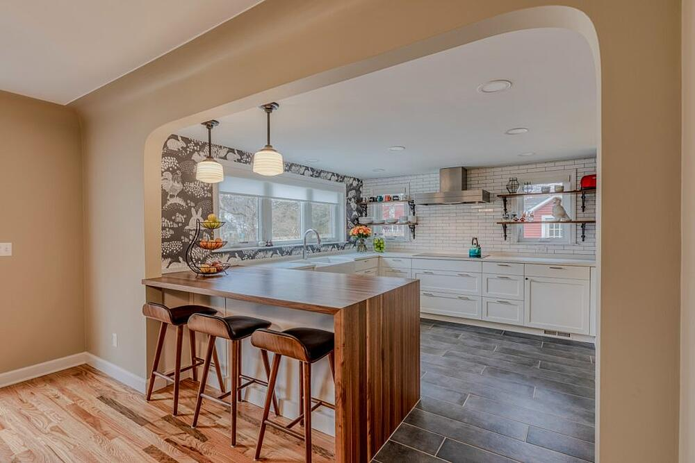 Kitchen Redesign and Remodel with waterfall walnut peninsula