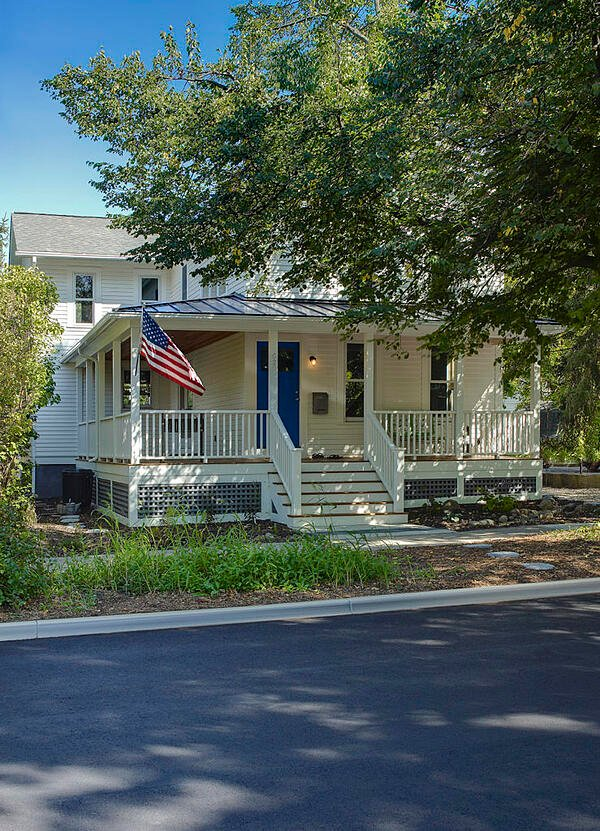 american flag front of house