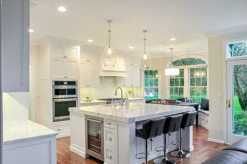 White kitchen cabinets, walls and countertops