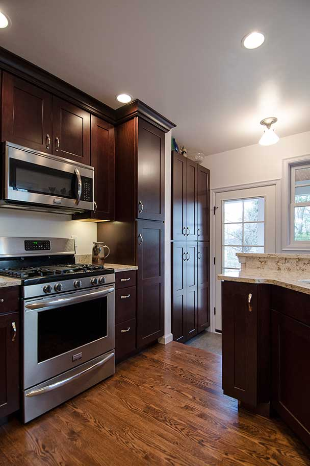 kitchen with dark wood cabinets and stainless steel appliances