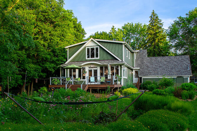 Exterior photo of two story addition by Meadowlark Design+Build